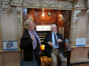 Joan and the organist sharing a laugh
